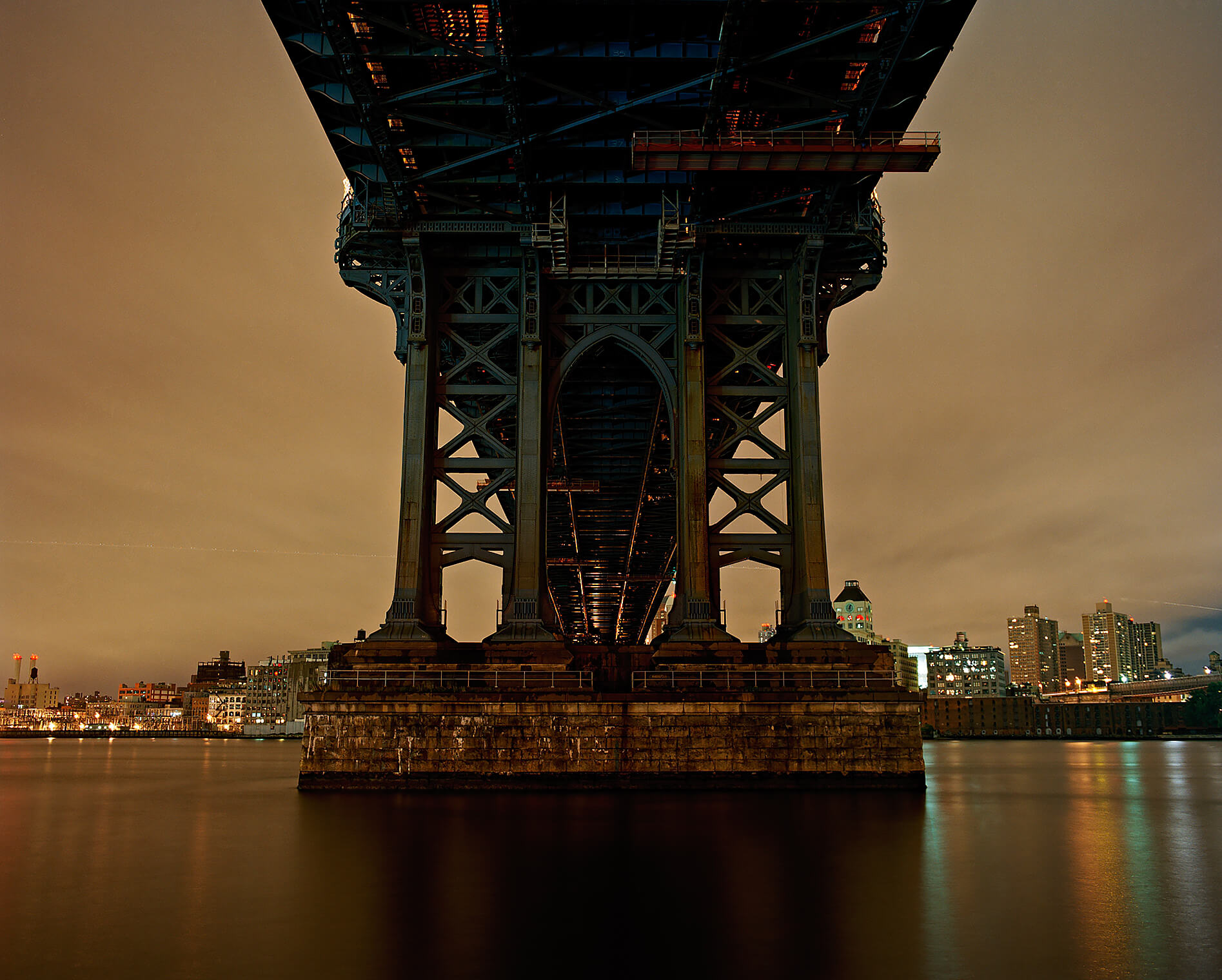 Night shot underneath the Manhattan Bridge in New York City