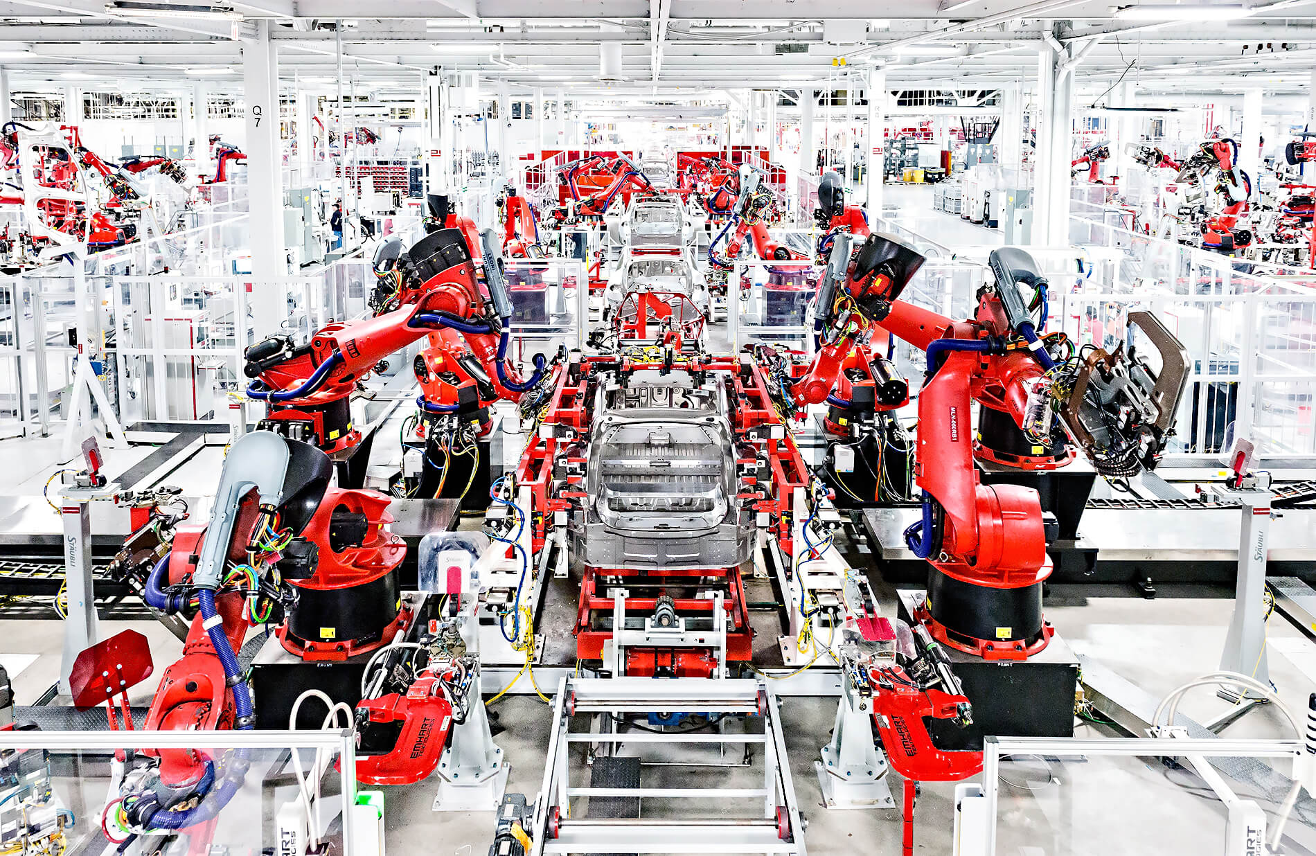 Robots assembling cars in the Tesla factory in Fremont, CA.