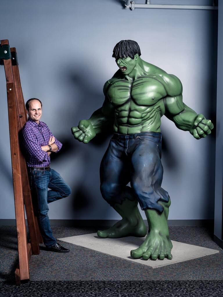 Laszlo Bock with Hulk statue at Google