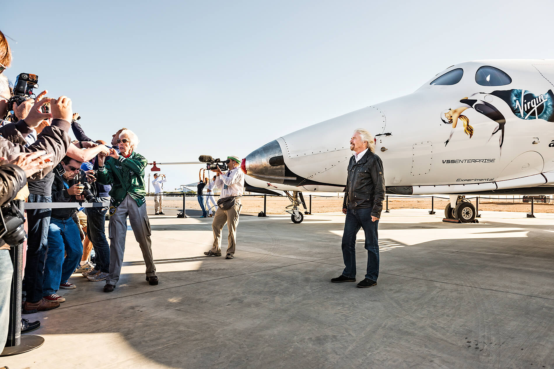Richard Branson with space craft SpaceShipTwo