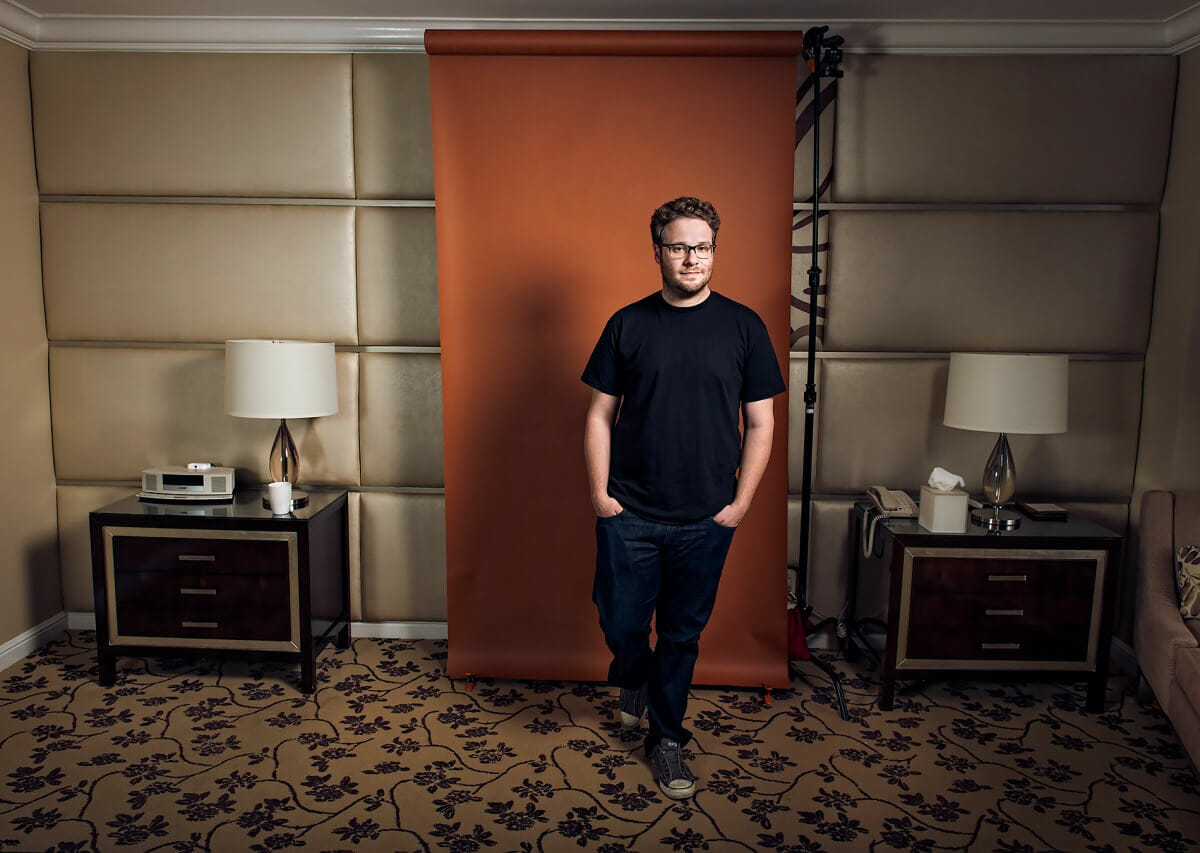 Seth Rogen in hotel room.