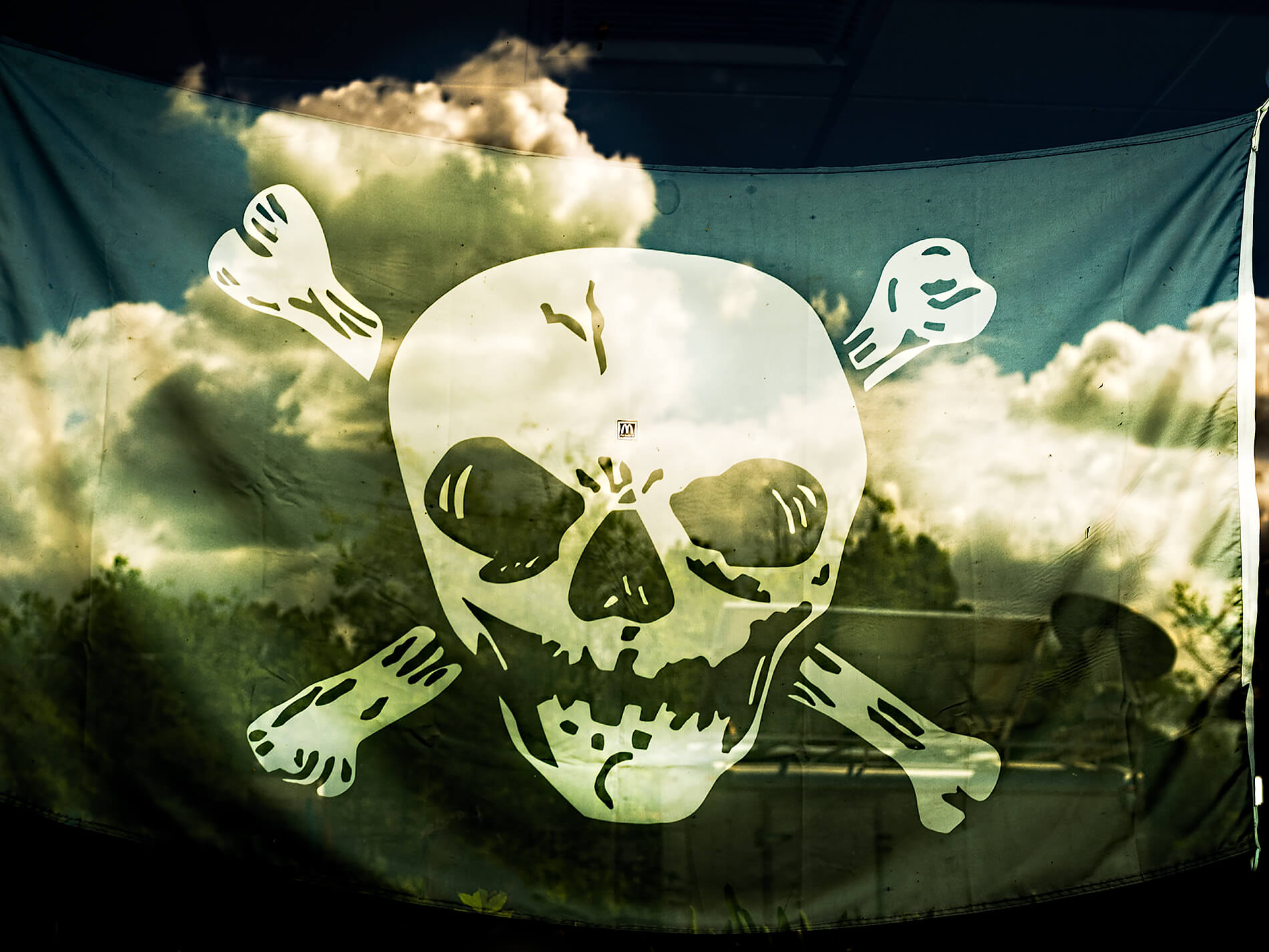 Pirate flag with clouds reflecting