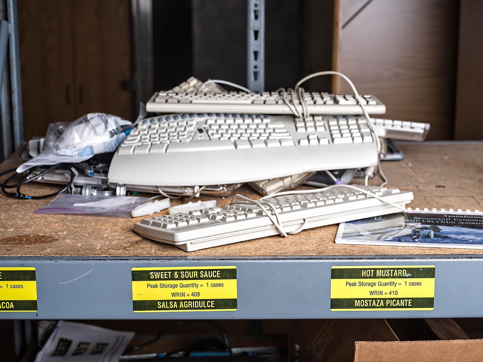 Keyboards on Mc Donald's storage shelf