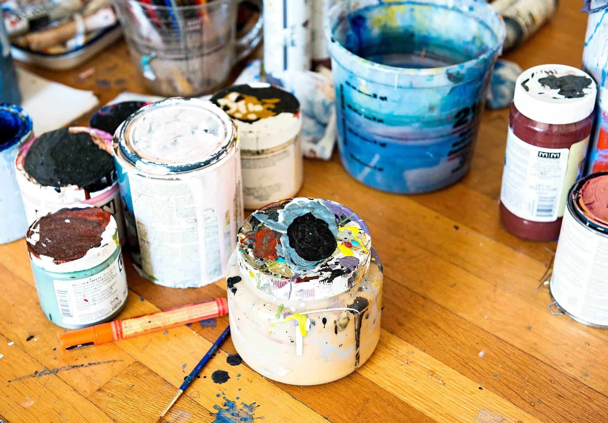 Paint cans on studio floor