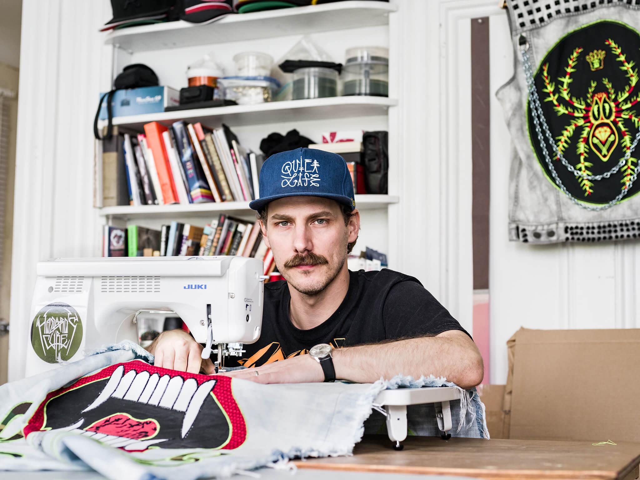 Ben Venom in his studio with sewing machine