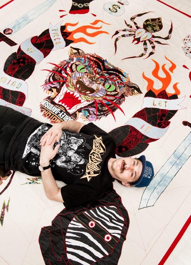 Ben Venom with homemade quilt