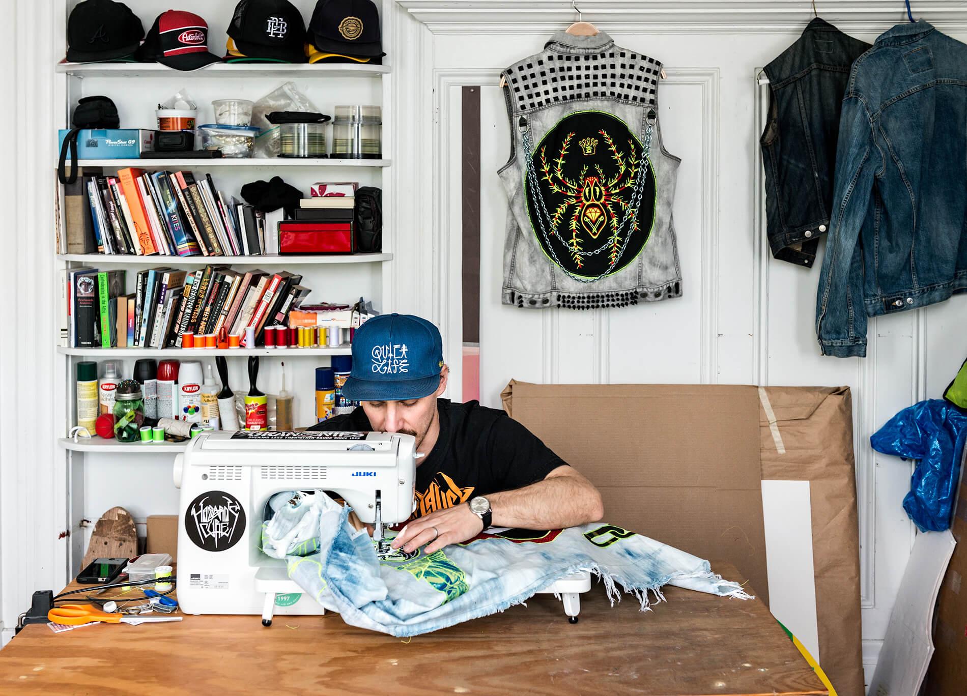 Ben Venom sewing in his studio