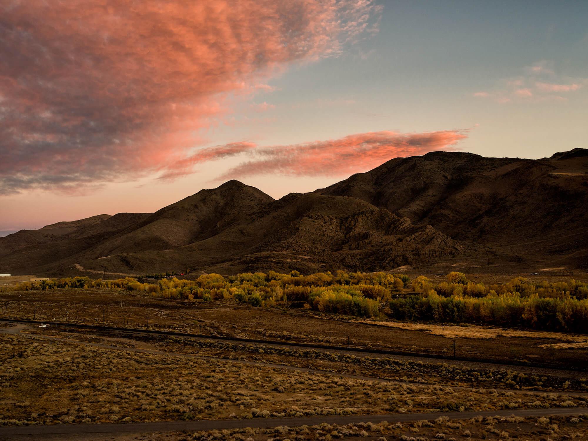 Sun setting behind mountain in Nevada