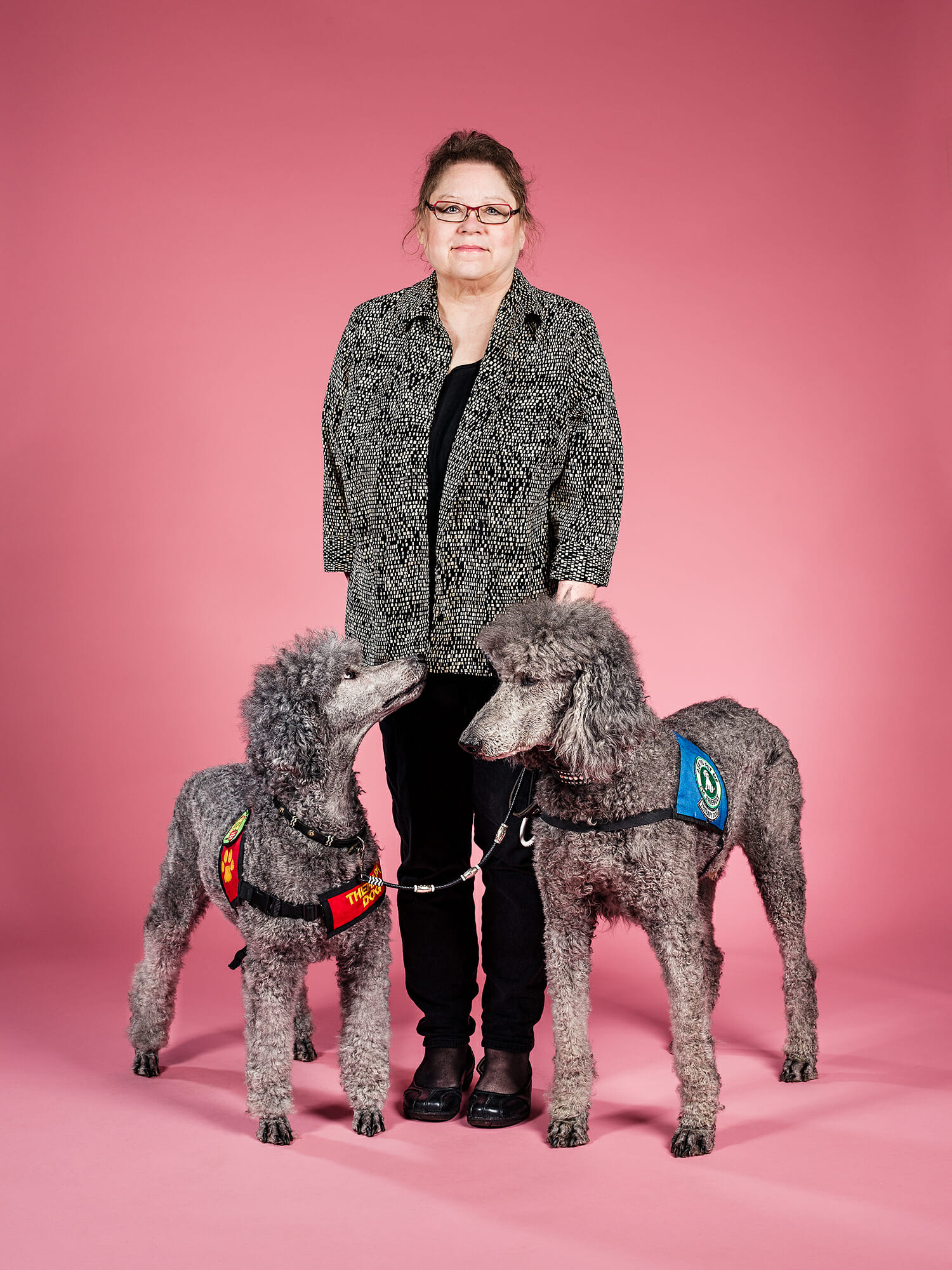 Poodle service dogs Titan and Jodie with owner Laura
