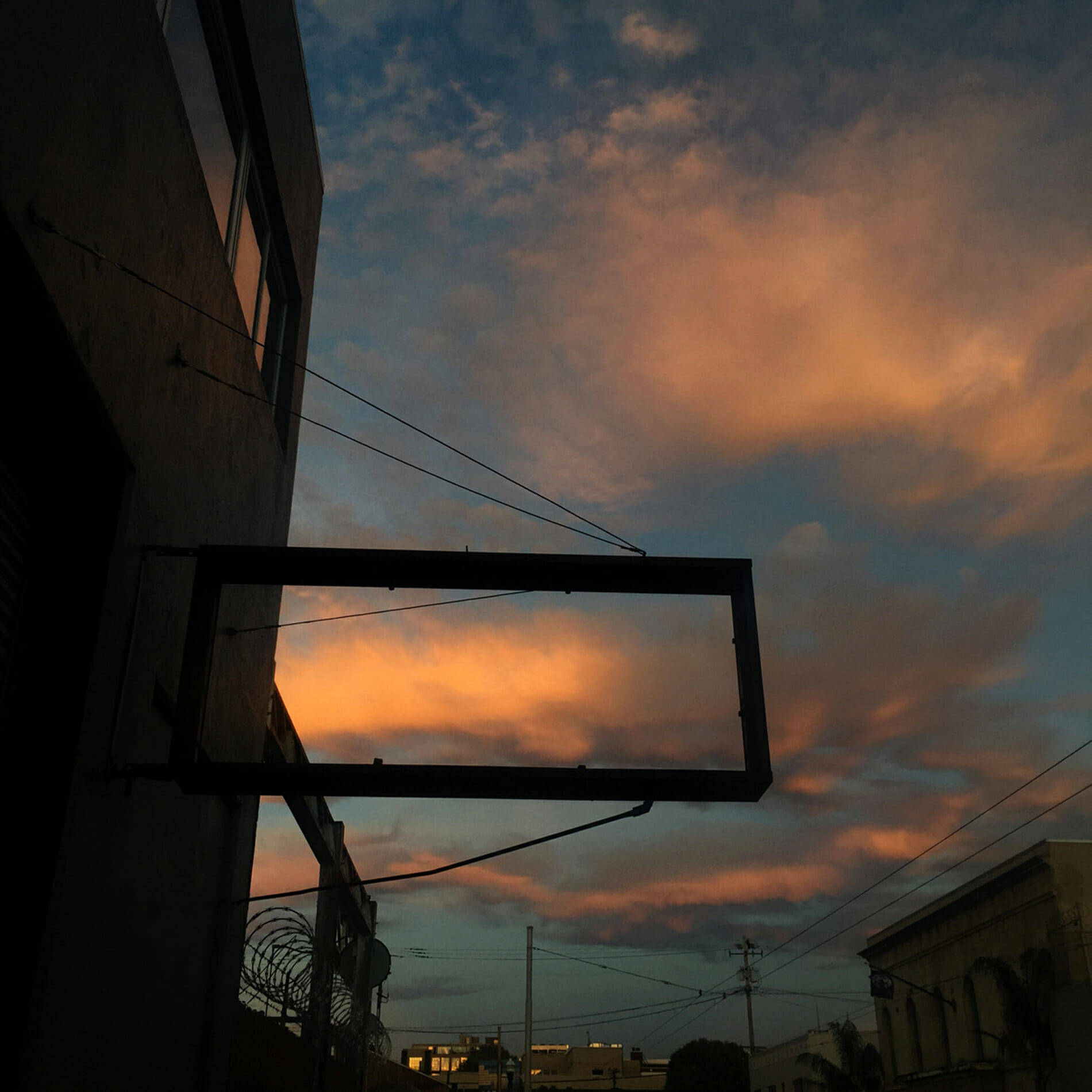 cloud framed by sign