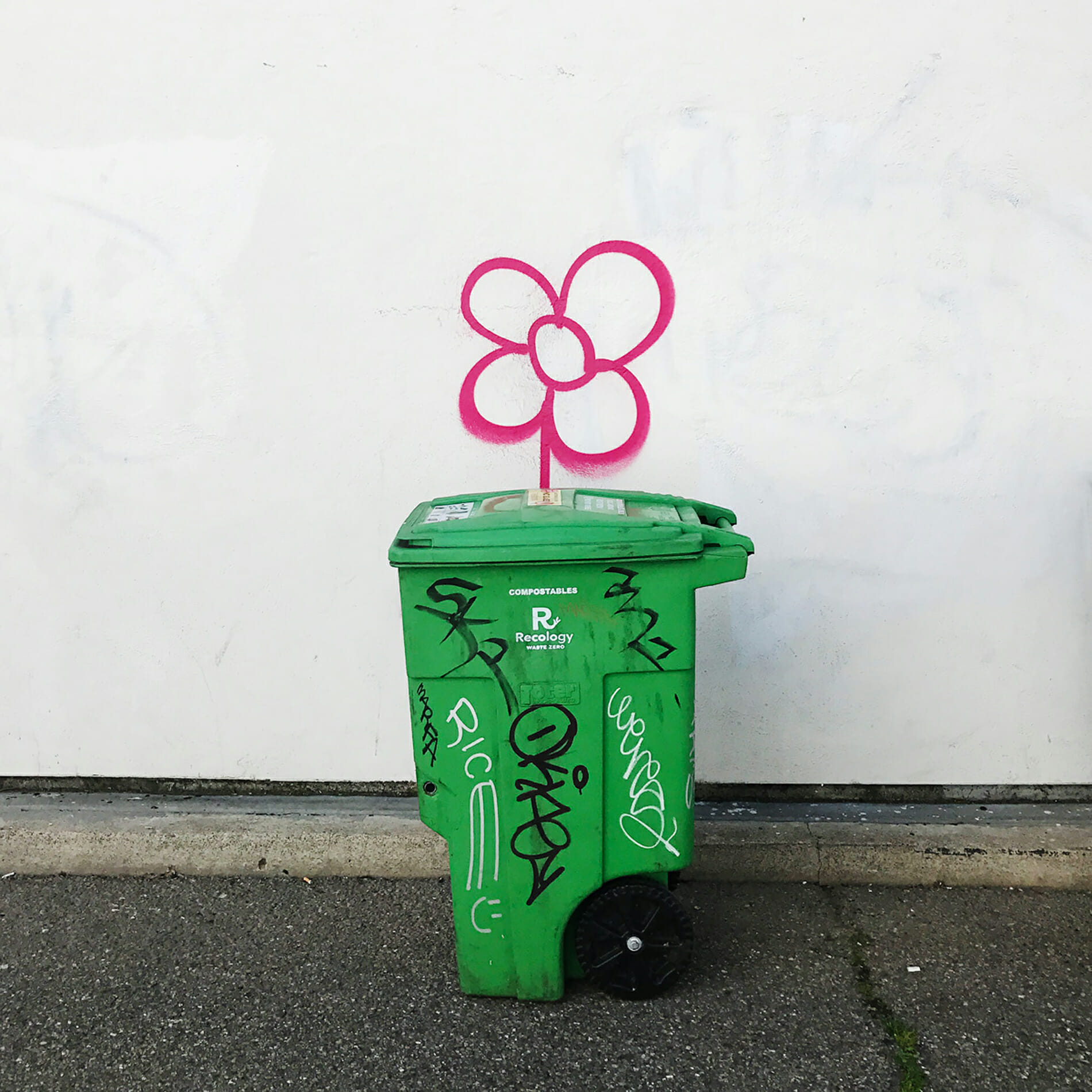 compost bin with graffiti flower