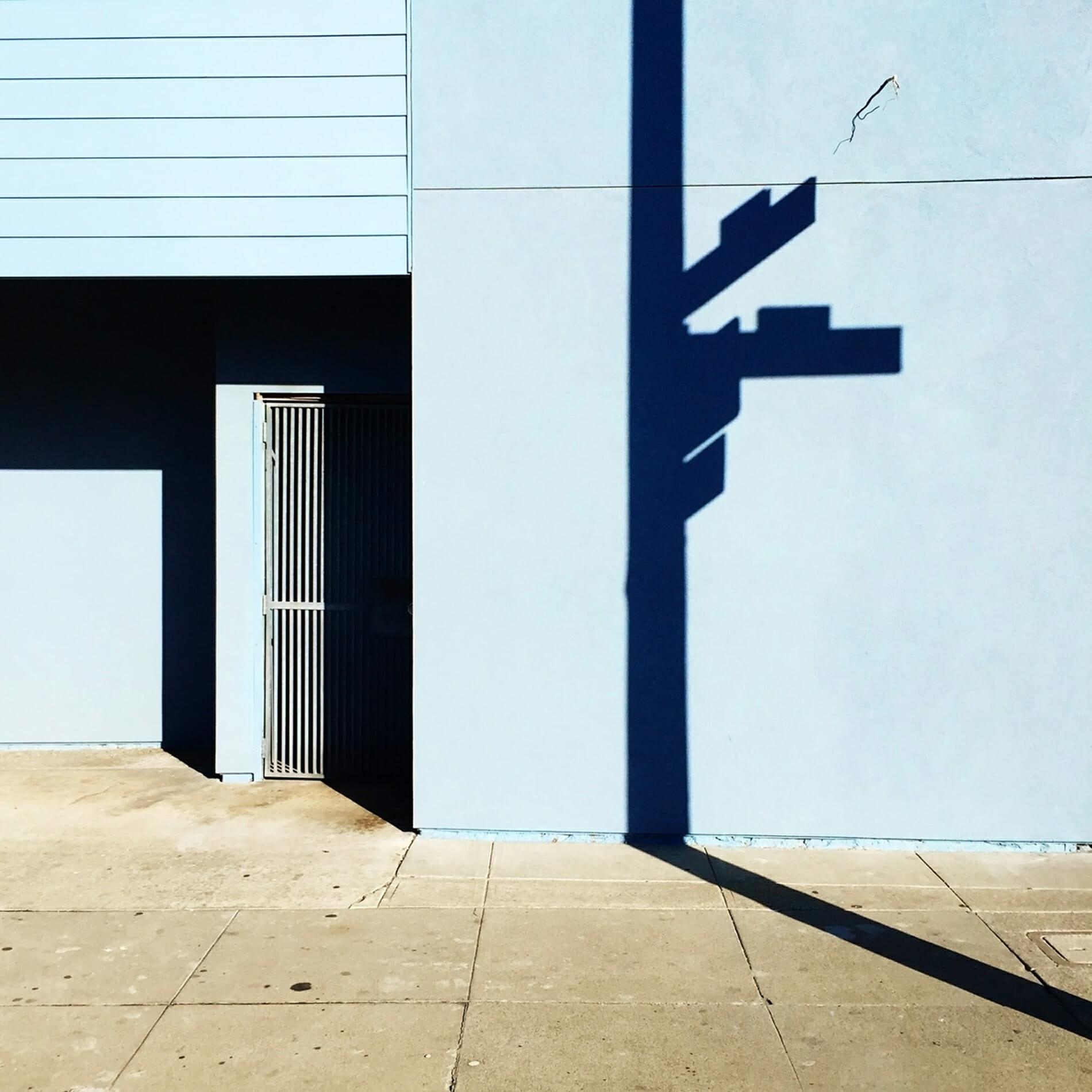 street sign shadow on motel wall