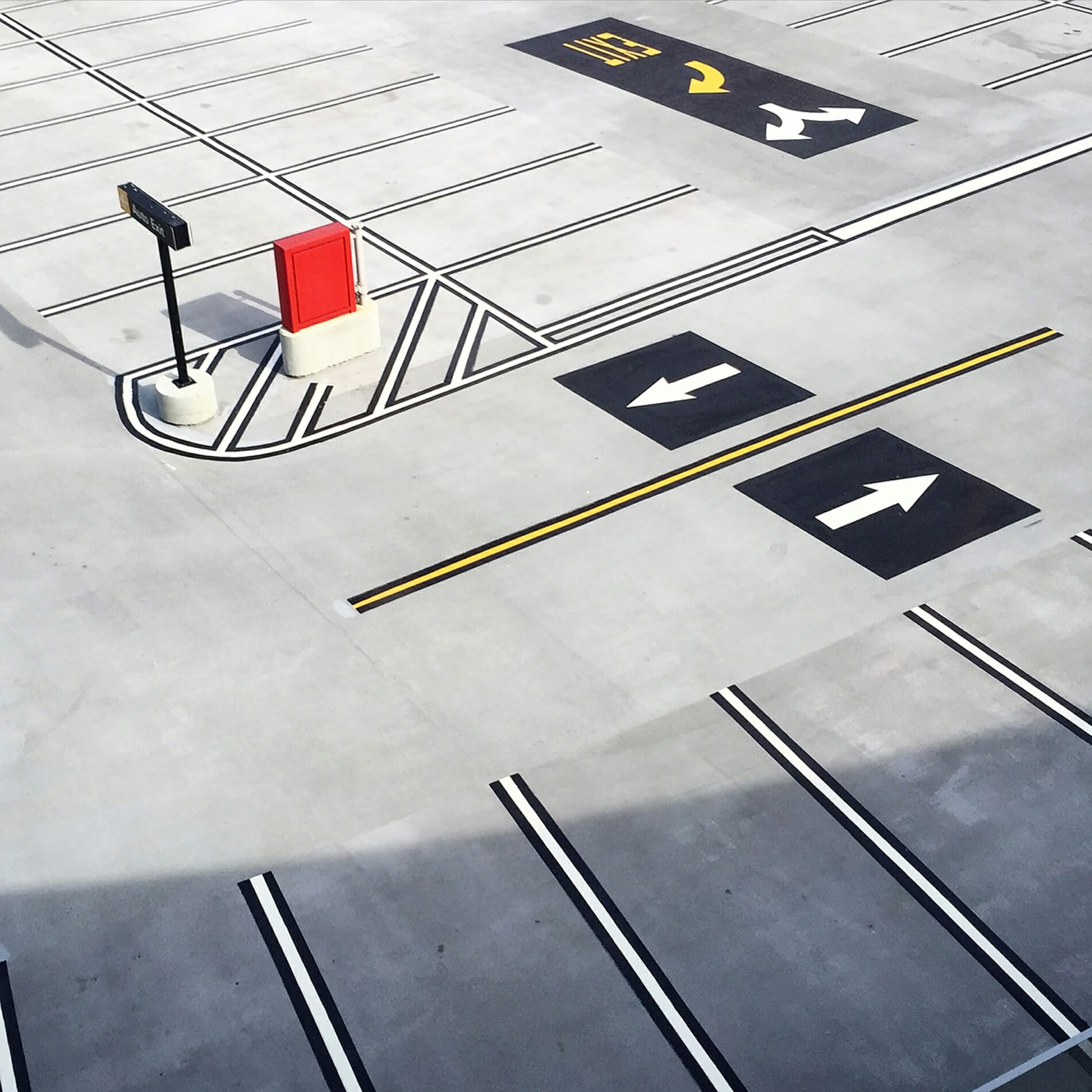 Arrows in airport parking lot