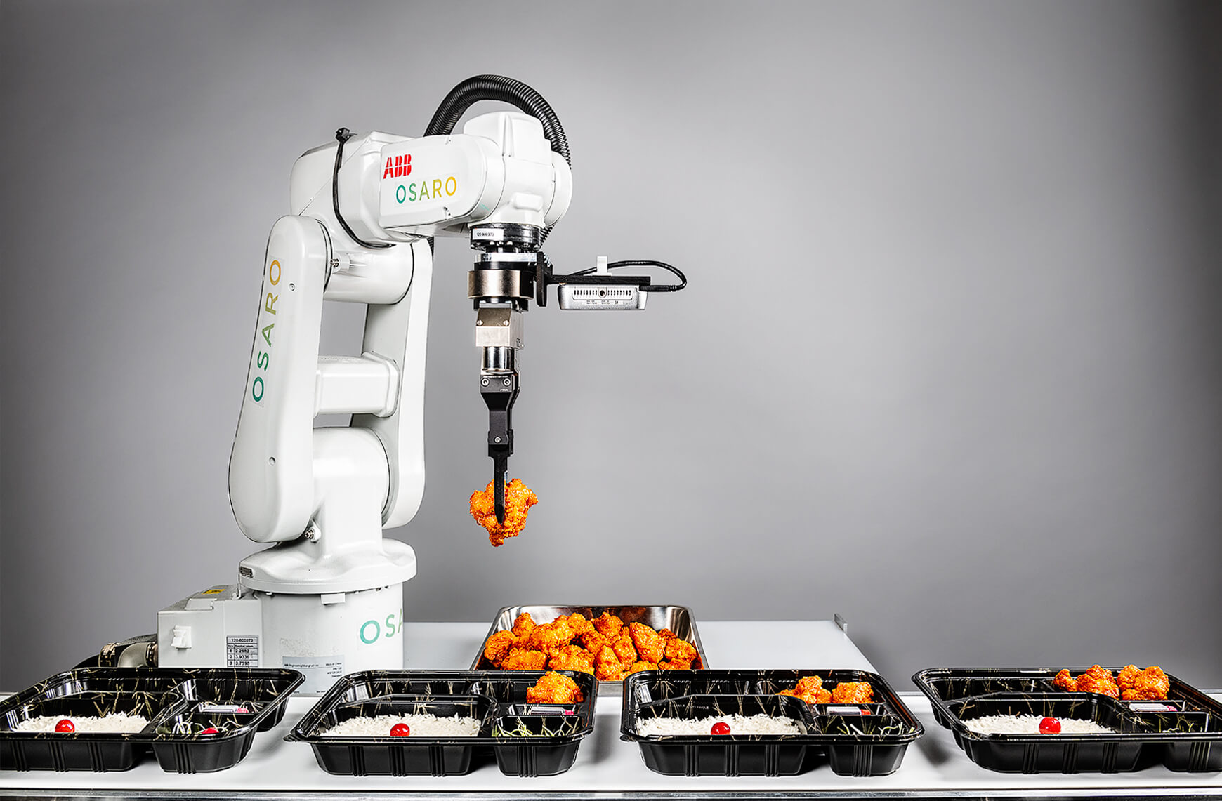Osaro robotic arm fills up bento boxes with chicken nuggets.