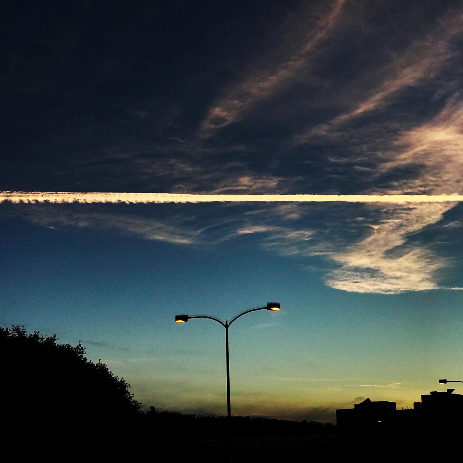exhaust trail through sky