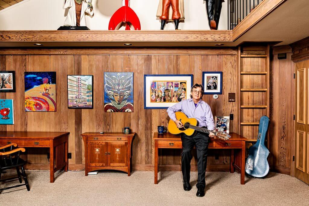 Roger McNamee plays guitar