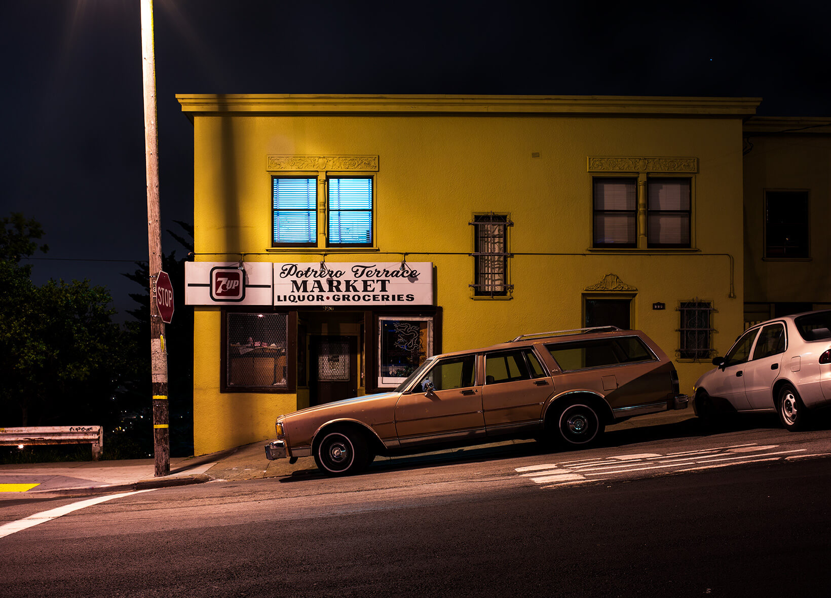 Station wagon at night in front of liquor store in Potrero Hill, San Francisco.