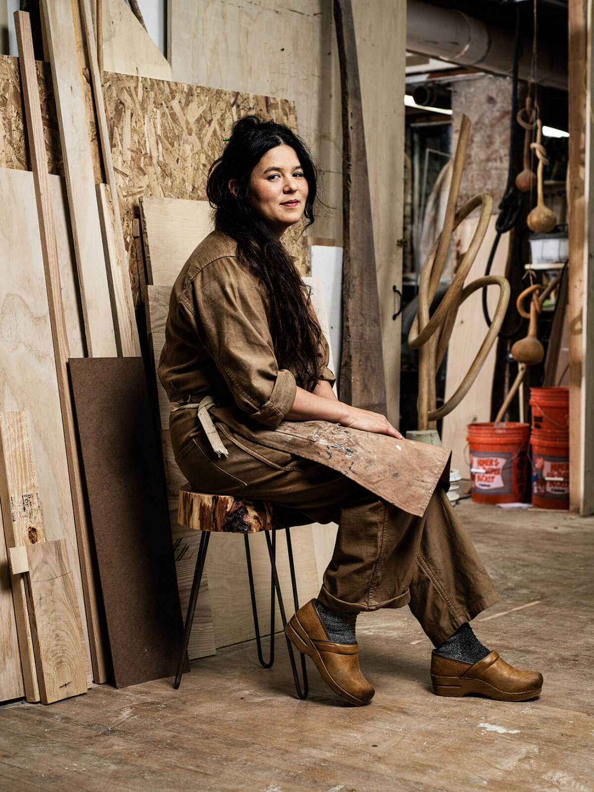 Portrait of artist Katie Gong in her wood shop