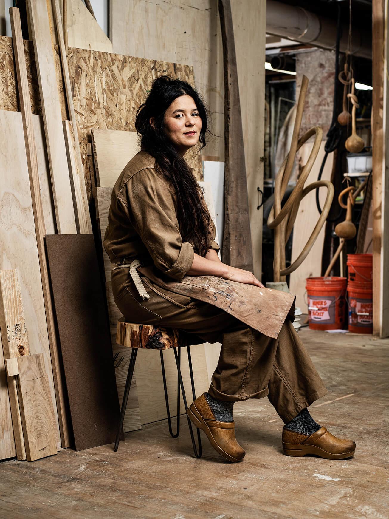 Portrait of artist Katie Gong in her wood shop
