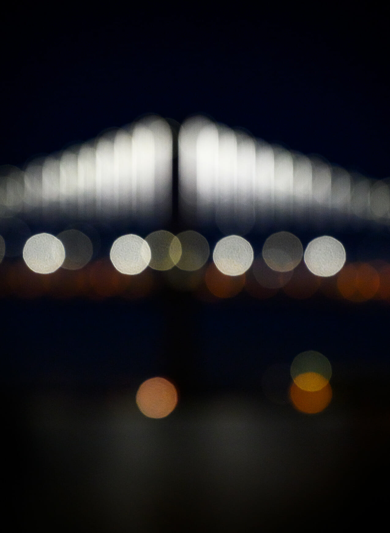 Abstract image of Bay Bridge in San Francisco at night.