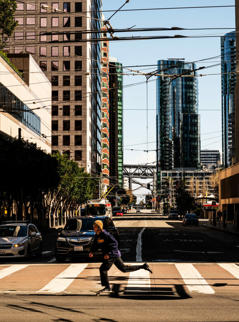 Skater in San Francisco's deserted streets during shelter-in-place.