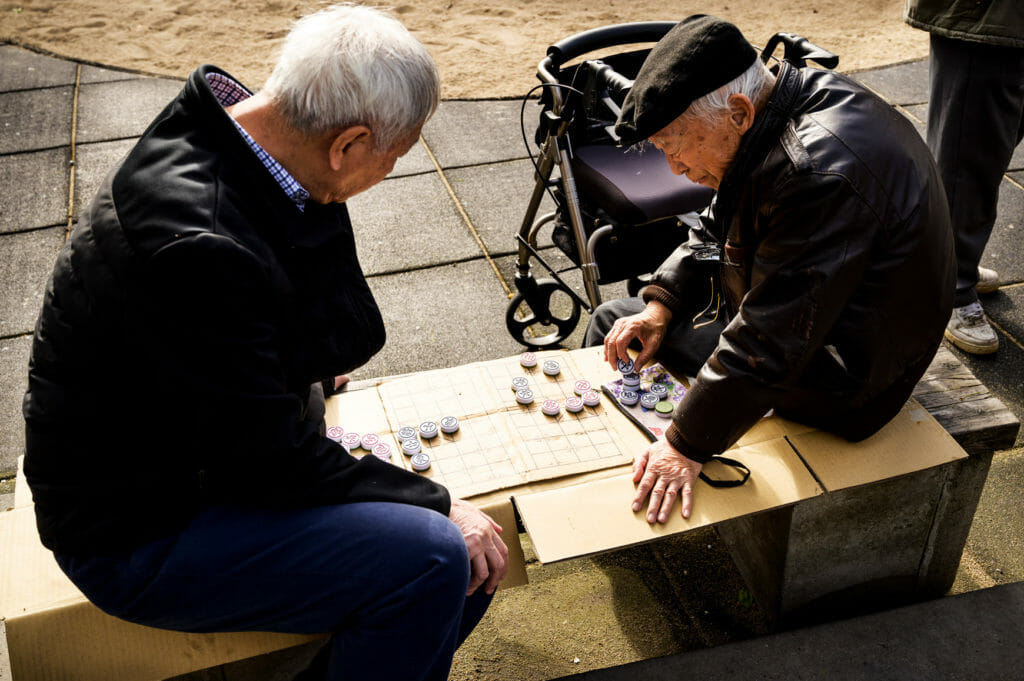 Two men playing board game in San Francisco's Chinatown