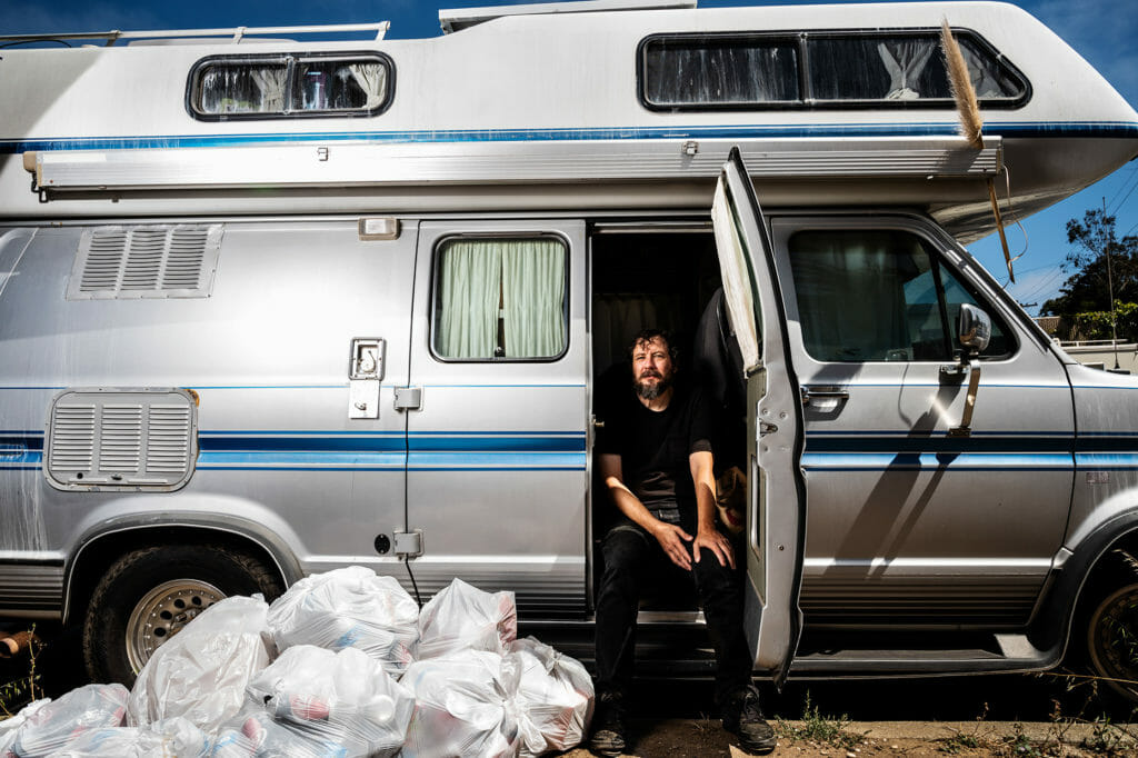 Dave and his camper van which he rents to live in